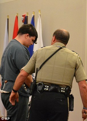 Andrew Andrea Balcer led away after guilty plea