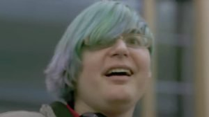 Green-Haired Male Transactivists Looks On