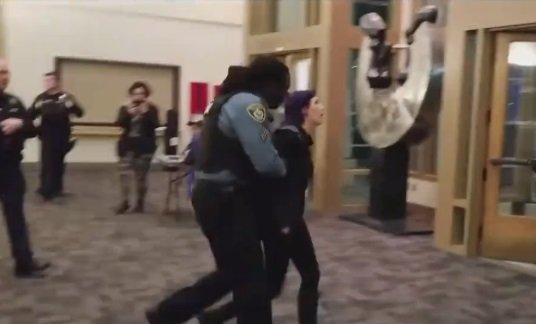 Police Escort Trans Activist From Assembly